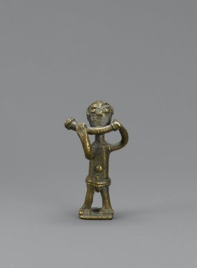 Akan. <em>Gold-weight (abrammuo): male figure</em>, 19th-20th century. Cast brass, 1 1/2 x 5/8 in. (3.8 x 1.6 cm). Brooklyn Museum, Gift of Mr. and Mrs. Franklin H. Williams, 88.192.63. Creative Commons-BY (Photo: Brooklyn Museum, 88.192.63_PS6.jpg)