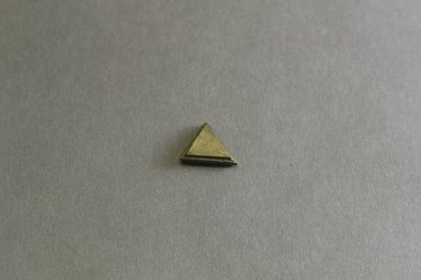 Akan. <em>Gold-weight (abrammuo): geometric</em>, 19th-20th century. Copper alloy, 3/4 x 5/8 x 1/4 in. Brooklyn Museum, Gift of Mr. and Mrs. Franklin H. Williams, 88.192.65. Creative Commons-BY (Photo: Brooklyn Museum, 88.192.65_front_PS5.jpg)