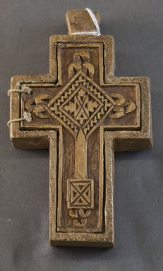 Amhara. <em>Pendant Cross</em>, 19th or 20th century. Wood, pigment, 5 1/2 x 3 1/4 in. (14.0 x 8.3 cm). Brooklyn Museum, Gift of Mr. and Mrs. Franklin H. Williams, 88.192.6. Creative Commons-BY (Photo: Brooklyn Museum, 88.192.6_front_PS10.jpg)