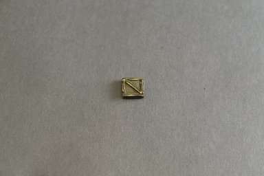 Akan. <em>Gold-weight (abrammuo): geometric</em>, 19th-20th century. Copper alloy, 1/2 x 1/2 x 1/8 in. Brooklyn Museum, Gift of Mr. and Mrs. Franklin H. Williams, 88.192.87. Creative Commons-BY (Photo: Brooklyn Museum, 88.192.87_front_PS5.jpg)