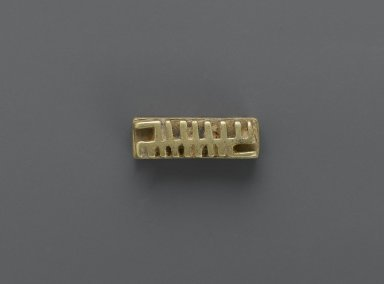 Akan. <em>Gold-weight (abrammuo): geometric</em>, 19th-20th century. Cast brass, 1/4 x 3/8 x 1 in. (0.6 x 1 x 2.5 cm). Brooklyn Museum, Gift of Mr. and Mrs. Franklin H. Williams, 88.192.88. Creative Commons-BY (Photo: Brooklyn Museum, 88.192.88_PS6.jpg)