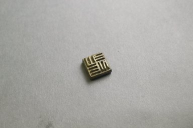 Akan. <em>Gold-weight (abrammuo): geometric</em>, 19th-20th century. Copper alloy, 5/8 x 5/8 x 1/4 in. Brooklyn Museum, Gift of Mr. and Mrs. Franklin H. Williams, 88.192.94. Creative Commons-BY (Photo: Brooklyn Museum, 88.192.94_front_PS5.jpg)
