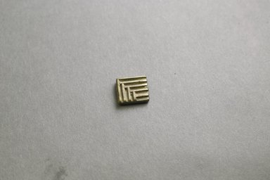 Akan. <em>Gold-weight (abrammuo): geometric</em>, 19th-20th century. Copper alloy, 5/8 x 1/2 x 1/8 in. Brooklyn Museum, Gift of Mr. and Mrs. Franklin H. Williams, 88.192.96. Creative Commons-BY (Photo: Brooklyn Museum, 88.192.96_front_PS5.jpg)