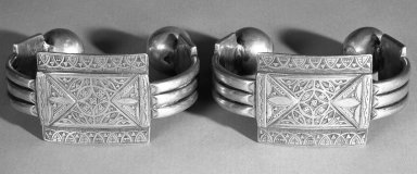 <em>Pair of Anklets</em>, late 19th century. Silver, diam: 4 1/8 in. (10.5 cm). Brooklyn Museum, Gift of Dr. Virgil H. Bird, 88.193.1a-b. Creative Commons-BY (Photo: Brooklyn Museum, 88.193.1a-b_bw.jpg)
