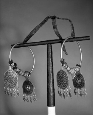 <em>Pair of Earrings</em>, late 19th century. Silver, beads, coins, cloisonne enamel, 5 1/2 x 5 in. (14 x 12.7 cm). Brooklyn Museum, Gift of Dr. Virgil H. Bird, 88.193.2a-b. Creative Commons-BY (Photo: Brooklyn Museum, 88.193.2a-b_bw.jpg)