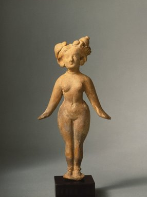 Taxila. <em>Standing Female</em>, 1st century C.E. Terracotta, overall (without base): 7 x 3 5/8 x 1 1/2 in. (17.8 x 9.2 x 3.8 cm). Brooklyn Museum, Gift of Georgia and Michael de Havenon, 88.194. Creative Commons-BY (Photo: Brooklyn Museum, 88.194_SL1.jpg)