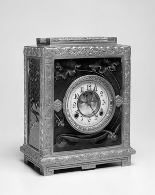New Haven Clock Company (working ca. 1853-1956). <em>Clock, Albatross</em>, Patented January 5, 1886. Brass and glazed earthenware tiles, 12 1/4 x 9 x 5 1/4 in. (31.1 x 22.9 x 13.3 cm). Brooklyn Museum, H. Randolph Lever Fund, 88.23. Creative Commons-BY (Photo: Brooklyn Museum, 88.23_bw.jpg)