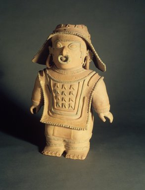 Jama Coaque. <em>Standing Figure</em>, 1-600 C.E. Ceramic, pigment, 18 3/4 x 13 1/4 x 6 1/2 in. (47.6 x 33.7 x 16.5 cm). Brooklyn Museum, Gift of Mr. and Mrs. Tessim Zorach, 88.57.1. Creative Commons-BY (Photo: Brooklyn Museum, 88.57.1.jpg)