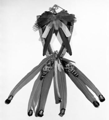 Kaapor. <em>Man's Neck Ornament</em>, 20th century. Feathers, fiber, bird skins, cotton cloth, bone, 9 x 30 x 1 1/2 in. (22.9 x 76.2 x 3.8 cm). Brooklyn Museum, Anonymous gift, 88.89.10. Creative Commons-BY (Photo: Brooklyn Museum, 88.89.10_acetate_bw.jpg)
