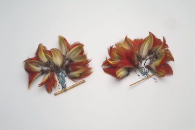 Shuar. <em>Pair of Ear Ornaments</em>, first half of the 20th century. Feathers, bamboo, glass beads, fiber, 4 1/2 x 3 1/2 x 4 in. (11.4 x 8.9 x 10.2 cm). Brooklyn Museum, Anonymous gift, 88.89.12a-b. Creative Commons-BY (Photo: Brooklyn Museum, 88.89.12a-b.jpg)