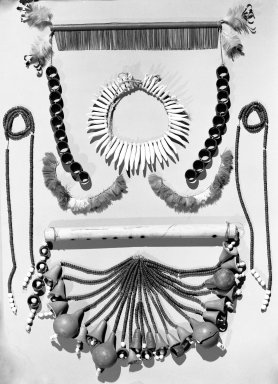 <em>Pair of Ear Ornaments</em>. Feathers, fiber Brooklyn Museum, Anonymous gift, 88.89.5a-b. Creative Commons-BY (Photo: , 88.89.3-.9_acetate_bw.jpg)