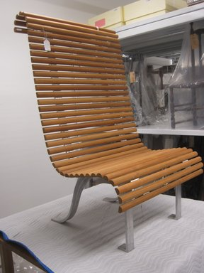 Andrée Putman (French, 1925-2013). <em>Chair, Teak Garden Collection</em>, 1999. Teak, aluminum, 53 x 31 1/2 x 30 in.  (134.6 x 80.0 x 77.5 cm). Brooklyn Museum, Gift of Furniture Co., 2000.21. Creative Commons-BY (Photo: Brooklyn Museum, COLL.2000.21_side.jpg)