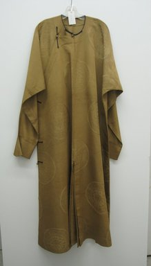 <em>Man's Long Coat with Buttons</em>, early 20th century. Brass, 52 3/4 x 78 3/4 in. (134 x 200 cm) width is at sleeves. Brooklyn Museum, Brooklyn Museum Collection, 34.1478. Creative Commons-BY (Photo: Brooklyn Museum, COLL.34.1478_front.jpg)