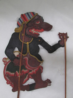 <em>Shadow-play Figure, Malaga(l or t)a</em>. Leather, pigment, wood, fiber, 19 7/8 × 11 13/16 in. (50.5 × 30 cm). Brooklyn Museum, Brooklyn Museum Collection, 00.153. Creative Commons-BY (Photo: , CUR.00.153_overall.jpg)