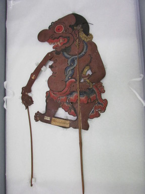 <em>Shadow-play Figure, Perebakesara or Perelakes Ara</em>. Leather, pigment, wood, fiber, 20 3/8 × 9 13/16 in. (51.8 × 25 cm). Brooklyn Museum, Brooklyn Museum Collection, 00.154. Creative Commons-BY (Photo: , CUR.00.154_overall1.jpg)
