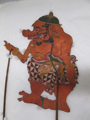 <em>Shadow Play Figure (Wayang kulit)</em>, before 1893. Leather, pigment, wood, fiber, 20 7/8 × 11 9/16 in. (53 × 29.3 cm). Brooklyn Museum, Brooklyn Museum Collection, 00.156. Creative Commons-BY (Photo: , CUR.00.156_overall.jpg)