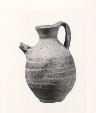 Cypriot. <em>Jug</em>. Clay, slip, 4 9/16 x Diam. 2 7/8 in. (11.6 x 7.3 cm). Brooklyn Museum, Anonymous gift, 00.165. Creative Commons-BY (Photo: Brooklyn Museum, CUR.00.165_print_NegA_bw.jpg)
