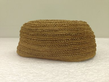 Yombe. <em>Cap</em>, 19th century. Vegetal fiber, height: 2 11/16 in. (6.8 cm); diameter: 6 1/8 in. (15.5 cm). Brooklyn Museum, Brooklyn Museum Collection, 00.76. Creative Commons-BY (Photo: Brooklyn Museum, CUR.00.76_side.jpg)