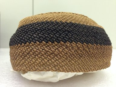 Yombe. <em>Cap</em>, 19th century. Vegetal fiber, height: 2 1/2 in. (6.3 cm); diameter: 6 in. (15.2 cm). Brooklyn Museum, Brooklyn Museum Collection, 00.81. Creative Commons-BY (Photo: Brooklyn Museum, CUR.00.81_side.jpg)