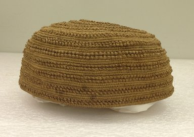 Yombe. <em>Plain Cap</em>, 19th century. Vegetal fiber, height: 2 3/8 in. (6.0 cm); diameter: 5 7/8 in. (14.9 cm). Brooklyn Museum, Brooklyn Museum Collection, 00.84. Creative Commons-BY (Photo: Brooklyn Museum, CUR.00.84_side.jpg)