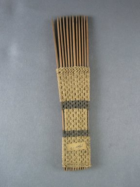 <em>Comb</em>. Light brown reed Brooklyn Museum, Brooklyn Museum Collection, 00.99.12. Creative Commons-BY (Photo: Brooklyn Museum, CUR.00.99.12_view1.jpg)