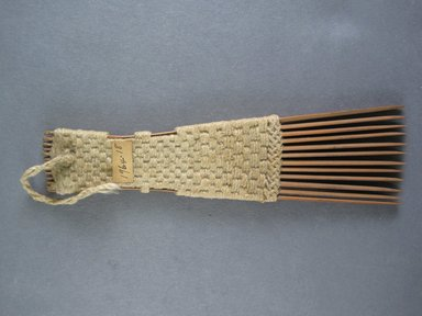 <em>Comb</em>. Light brown reed Brooklyn Museum, Brooklyn Museum Collection, 00.99.18. Creative Commons-BY (Photo: Brooklyn Museum, CUR.00.99.18_view1.jpg)