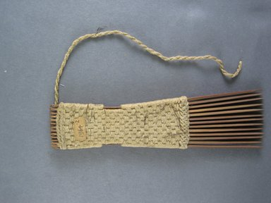 <em>Comb</em>. Light brown reed Brooklyn Museum, Brooklyn Museum Collection, 00.99.2. Creative Commons-BY (Photo: Brooklyn Museum, CUR.00.99.2_view1.jpg)