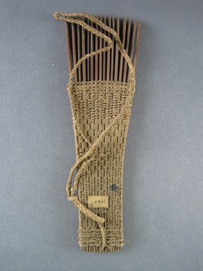 <em>Comb</em>. Light brown reed Brooklyn Museum, Brooklyn Museum Collection, 00.99.3. Creative Commons-BY (Photo: Brooklyn Museum, CUR.00.99.3_view1.jpg)