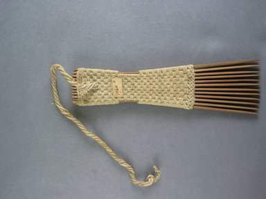 <em>Comb</em>. Light brown reed Brooklyn Museum, Brooklyn Museum Collection, 00.99.4. Creative Commons-BY (Photo: Brooklyn Museum, CUR.00.99.4_view1.jpg)