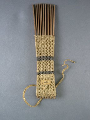 <em>Comb</em>. Light brown reed Brooklyn Museum, Brooklyn Museum Collection, 00.99.5. Creative Commons-BY (Photo: Brooklyn Museum, CUR.00.99.5_view1.jpg)