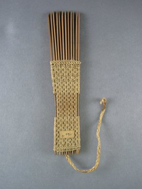 <em>Comb</em>. Light brown reed Brooklyn Museum, Brooklyn Museum Collection, 00.99.6. Creative Commons-BY (Photo: Brooklyn Museum, CUR.00.99.6_view1.jpg)