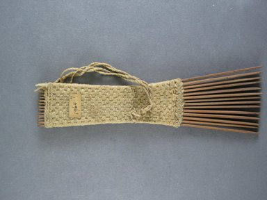 <em>Comb</em>. Light brown reed Brooklyn Museum, Brooklyn Museum Collection, 00.99.7. Creative Commons-BY (Photo: Brooklyn Museum, CUR.00.99.7_view1.jpg)