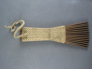 <em>Comb</em>. Light brown reed Brooklyn Museum, Brooklyn Museum Collection, 00.99.8. Creative Commons-BY (Photo: Brooklyn Museum, CUR.00.99.8_view1.jpg)
