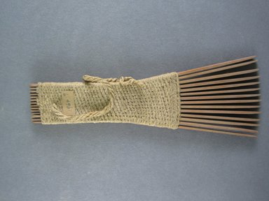 <em>Comb</em>. Light brown reed Brooklyn Museum, Brooklyn Museum Collection, 00.99.9. Creative Commons-BY (Photo: Brooklyn Museum, CUR.00.99.9_view1.jpg)