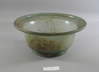 Roman. <em>Bowl of Molded Green Glass</em>, 1st-5th century C.E. Glass, 3 1/2 x Diam. 8 1/4 in. (8.9 x 20.9 cm). Brooklyn Museum, Gift of Robert B. Woodward, 01.105. Creative Commons-BY (Photo: Brooklyn Museum, CUR.01.105_view1.jpg)