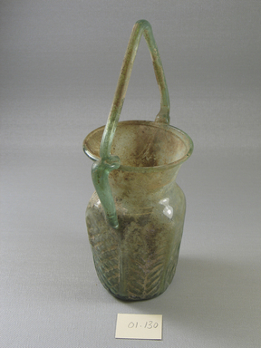 Roman. <em>Hexagonal Jar with Basket Handle</em>, 6th-early 7th century C.E. Glass, 8 1/2 x 3 5/16 x 4 3/8 in. (21.6 x 8.4 x 11.1 cm). Brooklyn Museum, Gift of Robert B. Woodward, 01.130. Creative Commons-BY (Photo: Brooklyn Museum, CUR.01.130_view3.jpg)