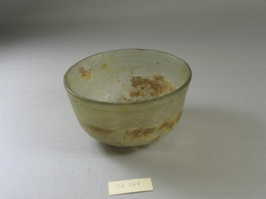 Roman. <em>Bowl of Plain Blown Glass</em>, 1st-5th century C.E. Glass, 2 1/16 x greatest diam. 4 in. (5.2 x 10.1 cm). Brooklyn Museum, Gift of Robert B. Woodward, 01.147. Creative Commons-BY (Photo: Brooklyn Museum, CUR.01.147.jpg)