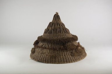 <em>Headdress with Conical Crown</em>, before 1898. Plant fiber, 10 5/8 x 13 3/4 in. (27 x 35 cm). Brooklyn Museum, 01.1501. Creative Commons-BY (Photo: Brooklyn Museum, CUR.01.1501_PS5.jpg)