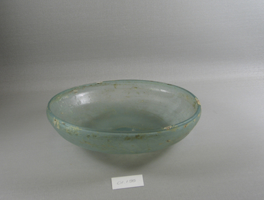 Roman. <em>Bowl of Blown Glass</em>, late 4th century C.E. Glass, 2 5/16 x Diam. 8 1/4 in. (5.8 x 21 cm). Brooklyn Museum, Gift of Robert B. Woodward, 01.155. Creative Commons-BY (Photo: Brooklyn Museum, CUR.01.155_view1.jpg)