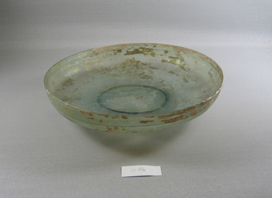 Roman. <em>Bowl of Plain Blown Glass</em>, 4th century C.E. Glass, 2 1/4 x Diam. 9 9/16 in. (5.7 x 24.3 cm). Brooklyn Museum, Gift of Robert B. Woodward, 01.156. Creative Commons-BY (Photo: Brooklyn Museum, CUR.01.156_view1.jpg)