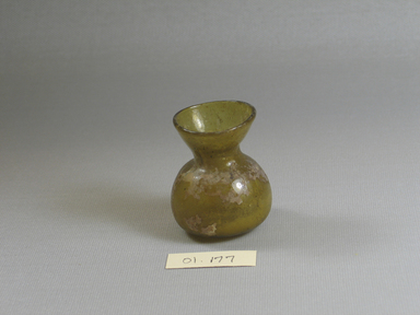 Roman. <em>Small Vase of Yellow Plain Blown Glass</em>, 1st-5th century C.E. Glass, 2 1/16 x Diam. 1 3/4 in. (5.2 x 4.4 cm). Brooklyn Museum, Gift of Robert B. Woodward, 01.177. Creative Commons-BY (Photo: Brooklyn Museum, CUR.01.177.jpg)