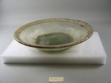 Roman. <em>Shallow Bowl of Molded Glass</em>, late 4th century C.E. Glass, 2 3/8 x Diam. 9 13/16 in. (6 x 25 cm). Brooklyn Museum, Gift of Robert B. Woodward, 01.182. Creative Commons-BY (Photo: Brooklyn Museum, CUR.01.182.jpg)
