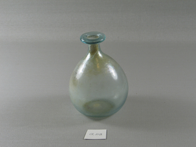 Roman. <em>Bottle of Blown Glass</em>, 3rd-7th century C.E. Glass, 4 x Diam. 3 3/8 in. (10.1 x 8.6 cm). Brooklyn Museum, Gift of Robert B. Woodward, 01.218. Creative Commons-BY (Photo: Brooklyn Museum, CUR.01.218_view1.jpg)