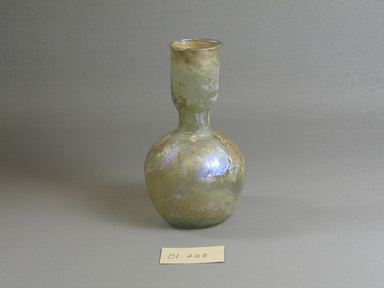 Roman. <em>Bottle of Plain Blown Glass</em>, 4th-5th century C.E. Glass, 4 7/16 x Diam. 2 1/2 in. (11.3 x 6.4 cm). Brooklyn Museum, Gift of Robert B. Woodward, 01.228. Creative Commons-BY (Photo: Brooklyn Museum, CUR.01.228.jpg)