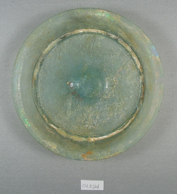 Roman. <em>Shallow Green Glass Blown Dish</em>, late 4th century C.E. Glass, gold, 11/16 x Diam. 5 13/16 in. (1.8 x 14.7 cm). Brooklyn Museum, Gift of Robert B. Woodward, 01.254. Creative Commons-BY (Photo: Brooklyn Museum, CUR.01.254_view1.jpg)
