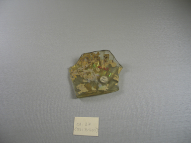 Roman. <em>Fragment</em>, 1st-5th century C.E. Glass, 1/2 x 3 3/8 in. (1.2 x 8.6 cm). Brooklyn Museum, Gift of Robert B. Woodward, 01.27. Creative Commons-BY (Photo: Brooklyn Museum, CUR.01.27_view1.jpg)