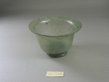 Roman. <em>Cup of Molded Green Glass</em>, 3rd-4th century C.E. Glass, 2 5/8 x greatest diam. 4 1/4 in. (6.7 x 10.8 cm). Brooklyn Museum, Gift of Robert B. Woodward, 01.326. Creative Commons-BY (Photo: Brooklyn Museum, CUR.01.326.jpg)