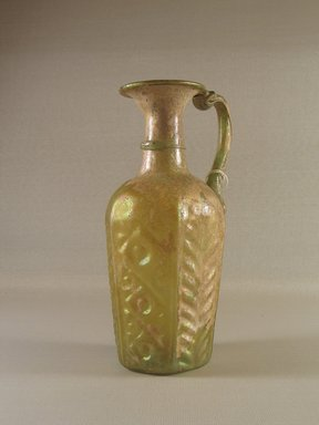 Roman. <em>Molded Jug</em>, 6th-early 7th century C.E. Glass, 7 3/16 x greatest diam. 3 1/16 in. (18.3 x 7.8 cm). Brooklyn Museum, Gift of Robert B. Woodward, 01.374. Creative Commons-BY (Photo: Brooklyn Museum, CUR.01.374_view1.jpg)