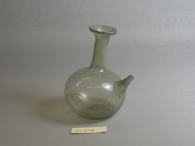 Roman. <em>Small Bottle</em>, 1st-5th century C.E. Glass, 3 7/8 x Diam. 2 11/16 in. (9.8 x 6.8 cm). Brooklyn Museum, Gift of Robert B. Woodward, 01.378. Creative Commons-BY (Photo: Brooklyn Museum, CUR.01.378.jpg)