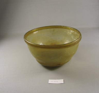 Roman. <em>Bowl of Molded Glass</em>, 1st-5th century C.E. Glass, 4 1/16 x greatest diam. 7 3/8 in. (10.3 x 18.8 cm). Brooklyn Museum, Gift of Robert B. Woodward, 01.407. Creative Commons-BY (Photo: Brooklyn Museum, CUR.01.407.jpg)